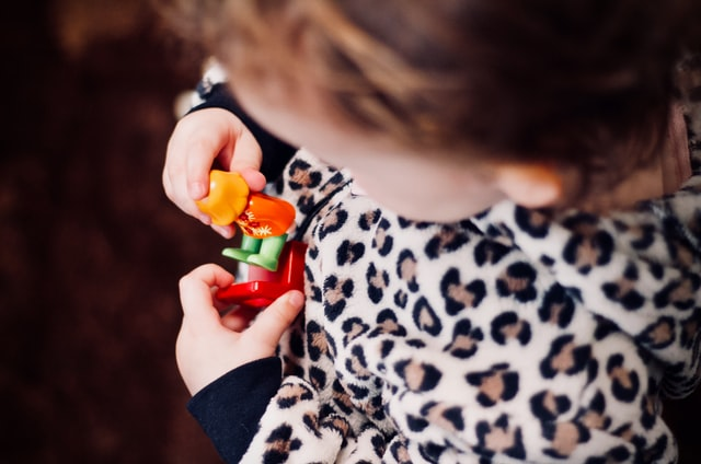 A birthday toddler playing pretend
